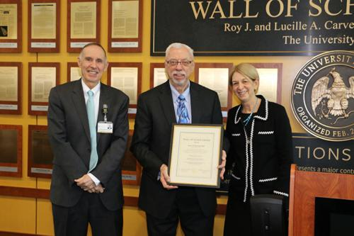 photo of Garry Buetter with Wall of Scholarship certificate